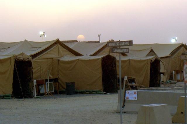 The Sun sets behind a unit living area at Camp Arifjan, Kuwait, June 1, 2008.