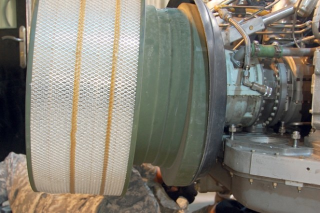 Field Service Engineer Ernest Rodriguez checks an M1 Abrams, AGT 1500 Turbine Engine for leaks during a dynamometer test, Saturday, May 31, at the 401st Army Field Support Brigade\'s Forward Repair Activity Total Integrated Engine Revitalization Shop, Camp Arifjan, Kuwait. Rodriguez, a Department of the Army civilian, deployed to Southwest Asia from Anniston Army Depot, Anniston, Ala. The goal of the TIGER program is to extend time between depot repairs with improved durability, a standard engine configuration, efficient supply-chain management, fact-based maintenance and expanded field support.