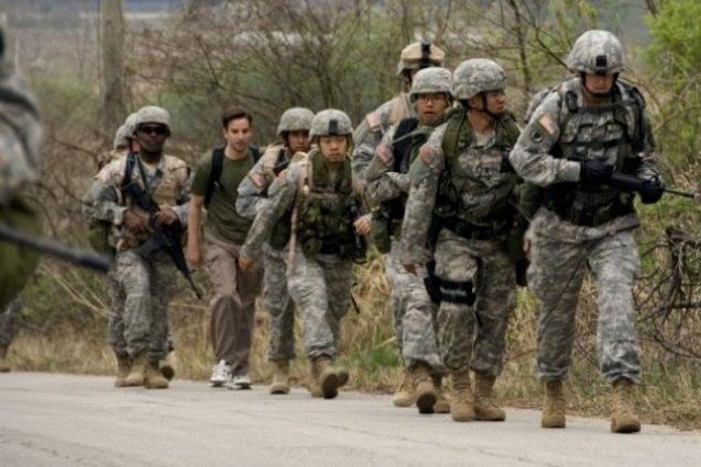 Soldiers from 2nd Bn., 9th Inf. Regt., 1st HBCT march along a route around Warrior Base and the DMZ during the Manchu Mile April 22. Soldiers endured the 25 mile march in honor of the 9th Infantry Regiment's exploits in Manchurian China.