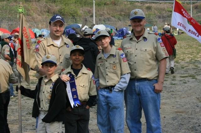 The USAG Humphreys Boy Scout Troop #203, consisting of (l to r)  Mathew Collins, Jared Collins (back), Jose Lopez, Tommy Bain, and Tom Bain, are the smallest troop in the ROK.