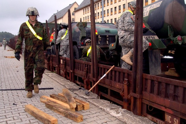 Soldiers from the 1st Battalion, 94th Field Artillery, chock the wheels of unit vehicles in place at the railhead in Baumholder, Germany in August 2007 as the unit prepared to departed for Romania to take part in the Joint Task Force-East 'proof of principle' exercise. The U.S. Department of Defense has announced that Baumholder has been added to the enduring base list for Europe.