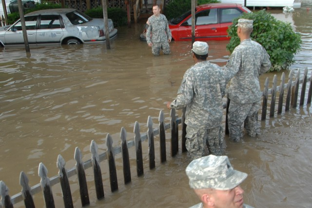 Greenfield Soldiers of 1st Battalion, 150th Field Artillery help residents in Martinsville, Ind. evacuate their home Saturday, June 7, 2008. Soldiers were sent out to help citizens in flash flooded areas of the city.