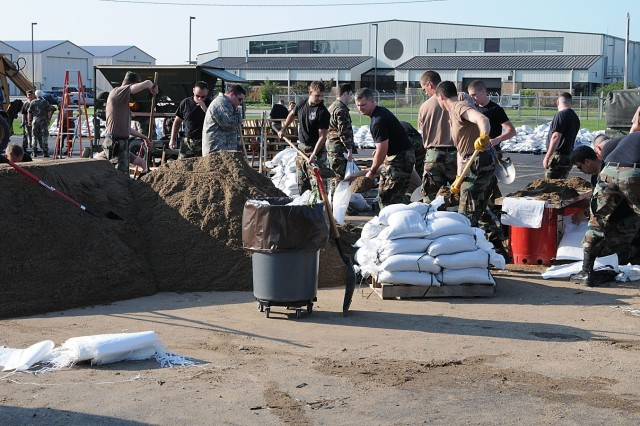 181 Intelligence Wing, Terre Haute, Ind., continuously fill sand bags in relief following the flood waters that hit Vigo County early Saturday morning.
