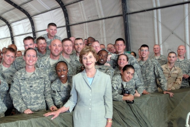 First Lady Laura Bush poses with service members at Bagram Air Field. She visited service members to thank them for their efforts in Afghanistan.