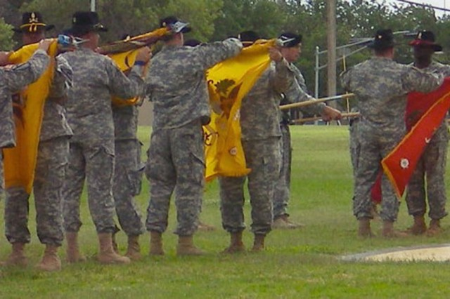 """The 4th """"Long Knife"""" Brigade Combat Team, 1st Cavalry Division battalion commanders and command sergeants major case their unit colors during the brigade's color casing ceremony at Cooper Field June 4. The Long Knife Brigade is scheduled to deploy to Iraq in mid-June."""