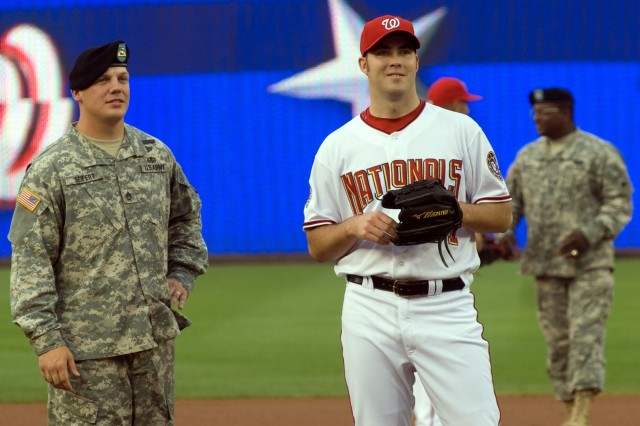 """Staff Sgt. Jason Seifert, 4th Squad Leader, 1st Platoon, A Co., the Old Guard, Fort Myer, Va., meets with Washington Nationals pitcher Jason Bergmann prior to the start of a June 6 game between the Washington Nationals and the San Francisco Giants at Nationals Park, Washington, D.C. Seifert, the Army NCO of the Year,  was given the opportunity to throw out """"the first pitch"""" prior to the start of the game. The evening was billed as """"Army Night"""" at the stadium."""