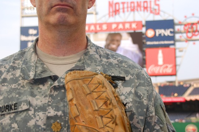 "Maj. Jeff Burke, 202nd Military Intelligence Squadron, D.C. National Guard, was one of more than a dozen military members to participate in the opening events prior to the June 6 game between the Washington Nationals and the San Francisco Giants at Nationals Park, Washington, D.C. The evening was billed as ""Army Night"" at the stadium."
