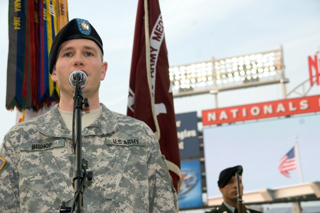 "Master Sgt. Allen Bishop, U.S. Army Field Band Soldiers' Chorus, performs the National Anthem, June 6, at Nationals Park, Washington, D.C., before a game between the Washington Nationals and the San Francisco Giants. The evening was billed as ""Army Night"" at the stadium."