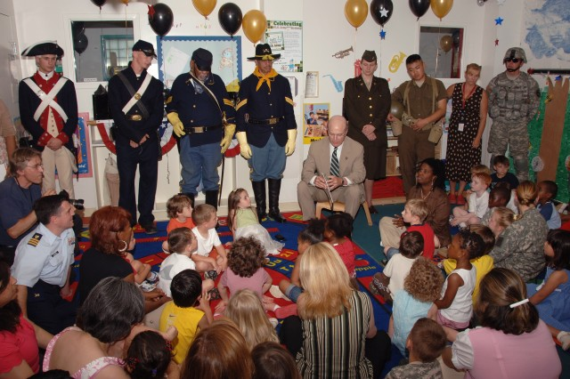 "Secretary of the Army Pete Geren kicks off the 233rd Army Birthday Week celebration by reading ""Happy Birthday Army"" storybook to children at the Fort Myer Child Development Center on June 9."