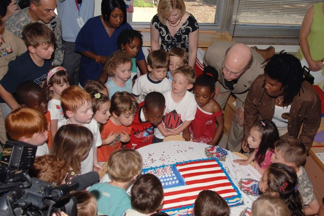 Secretary of the Army Pete Geren kicks off the 233rd Army Birthday Week celebration by blowing out the candles on an Army Birthday cake with young Army family members  at the Fort Myer's Child Development Center, June 9.