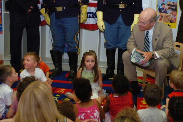 "Secretary of the Army Pete Geren kicks off the 233rd Army Birthday Week celebration by reading the ""Happy Birthday Army"" storybook to children at the Fort Myer Child Development Center, June 9."