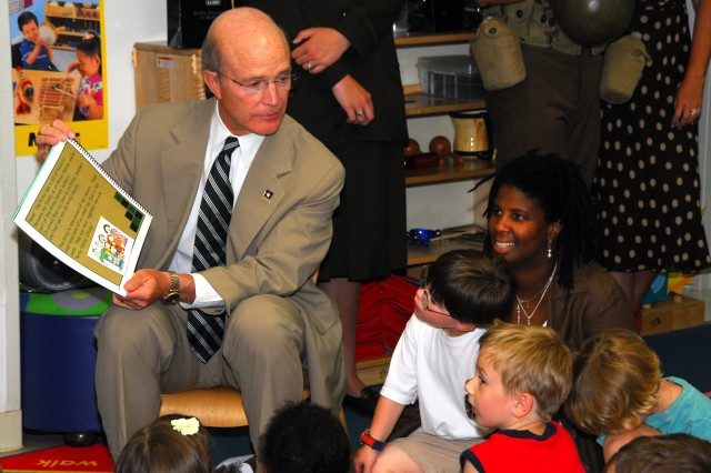 """Secretary of the Army Pete Geren reads to children at the Fort Myer, Va. Child Development Center a new book titled """"Happy Birthday Army,"""" June 9. The book was part of an effort to better include Army youth in the service's 233rd birthday"""