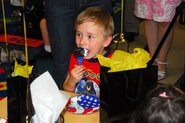 """Children at the Fort Myer, Va. Child Development Center enjoyed birthday cake, June 9,  after having heard a new book, """"Happy Birthday Army,"""" read to them by Secretary of the Army Pete Geren. The book was part of an effort to better include Army youth in the service's 233rd birthday celebrations."""