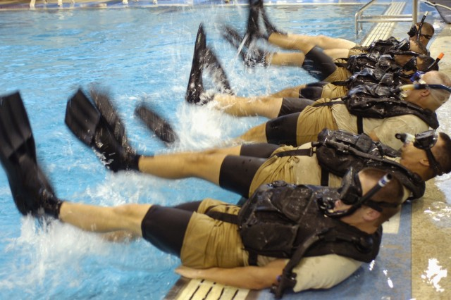 Combat engineers from the Corpus Christi-based 627th Heavy Dive Team, 36th Infantry Division, Texas Army National Guard, undergo intense physical fitness training for their six-month Navy dive school course.
