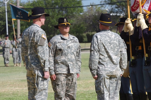 Standing ready to assume responsibility, Command Sgt. Maj. Rory L. Malloy (center), the incoming 1st Cavalry Division command sergeant major, prepares to receive the 1st Cav. Div. guidon from Maj. Gen. Daniel P. Bolger (left), commanding general, 1st Cav. Div. and Command Sgt. Maj. Donald R. Felt, the division's outgoing command sergeant major, during a change of responsibility ceremony at Fort Hood, Texas June 10.
