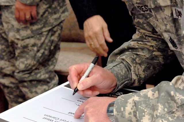 Sergeant Major of the Army Kenneth O. Preston signs the Fort Carson Army Community Covenants in a ceremony at the Colorado Springs, Colo., El Pomar Center June 6.