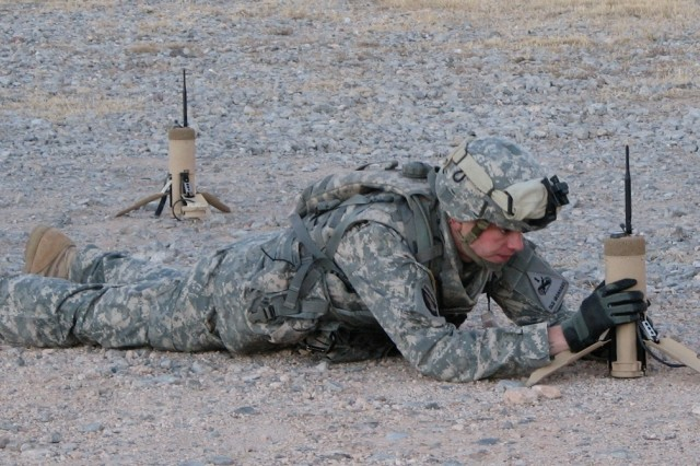 An Army Evaluation Task Force Soldier at Fort Bliss conducts training with an unattended ground sensor, or UGS.