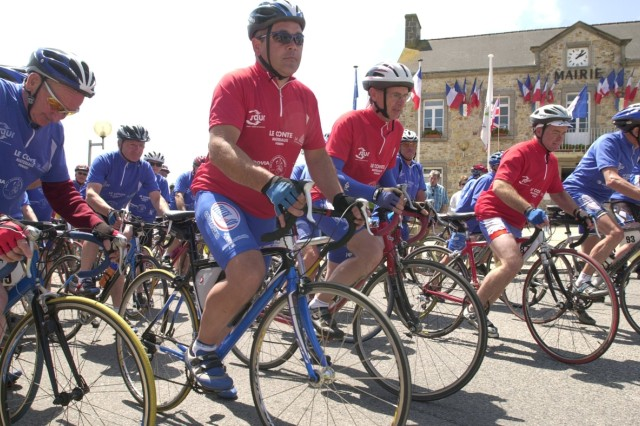 Cyclists from the first peloton are grouped together readying for the second stage which is leaving Les Pieus, and headed to Nehou, France, where they will visit a memorial dedicated to Gen. George S. Patton.