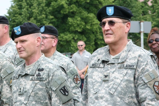 Maj. Gen. Yves Fontaine, commander of the 21st Theater Sustainment Command, and Chaplain (Col.) Curtis Wells, U.S. Army Garrison Grafenwoehr staff chaplain, watch the change of command ceremony.