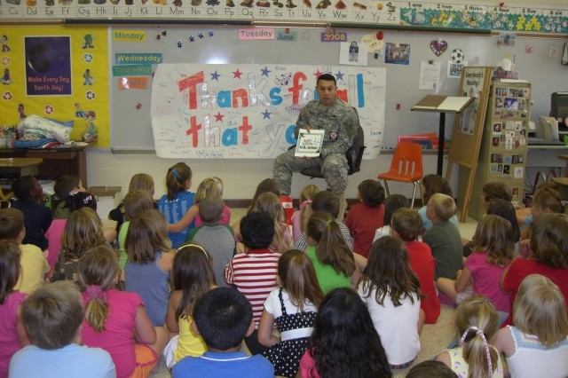 Capt. Richard Ramos from Fort Lee, Va., reads the Army Birthday Book to children at Tussing Elementary School in Colonial Heights June 10. Students enjoyed learning Army history in celebration of the Army's 233rd birthday as Soldiers assigned to Fort Lee and Fort Pickett volunteered to meet with schoolchildren from the local communities.