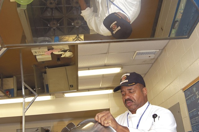 Juan Delvalle, Fort Lee Army Center of Excellence, Subsistence instructor, pours cake batter into a baking pan in preparation for the official Army birthday cake. It will serve 300 at the Army Birthday Celebration at Williams Stadium, June 13. The recipe for the official Army Birthday Cake for Friday's celebration includes 30 boxes of cake mix, eight dozen eggs, 48 pounds of powdered sugar, 16 pounds of shortening and 10 cups of salad oil.
