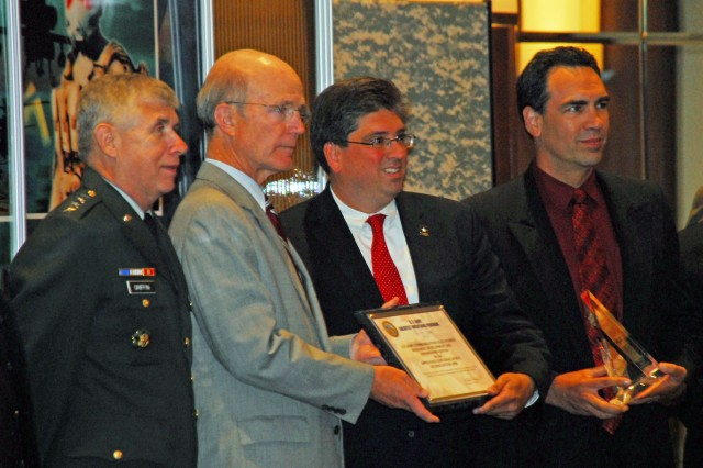 Gen. Benjamin S. Griffin, commanding general of the U.S. Army Materiel Command, and Secretary of the Army Pete Geren present an award to team leaders from U.S. Army Communications-Electronics Research, Development and Engineering Command for their invention, the Improvised Explosive Device Interrogation Arm, during the 2008 Army's Top Ten Greatest Inventions awards ceremony at the Hyatt Regency Hotel in Crystal City, June 12.