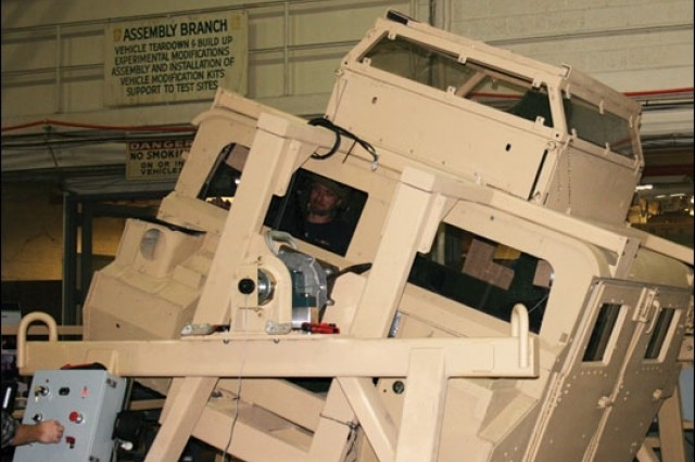 The HMMWV Egress Assistance Trainer. HEAT teaches Soldiers how to react in a vehicle rollover situation by properly and safely training them on how to open safety restraints and exit the Humvee from various rotated positions.