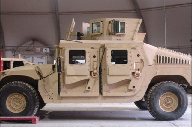 The Objective Gunner Protection Kit. The integrated turret is mounted onto tactical and armored vehicles for increased protection from explosive devices and small arms fire.