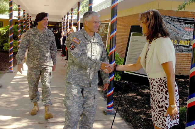 Gen. George W. Casey Jr., Army Chief of Staff, greets DFMWR workers outside Markham School Age Services at Fort Belvoir Thursday. Casey took part in celebrating the Army Birthday at the post. Installation Commander Col. Brian W. Lauritzen accompanied him.