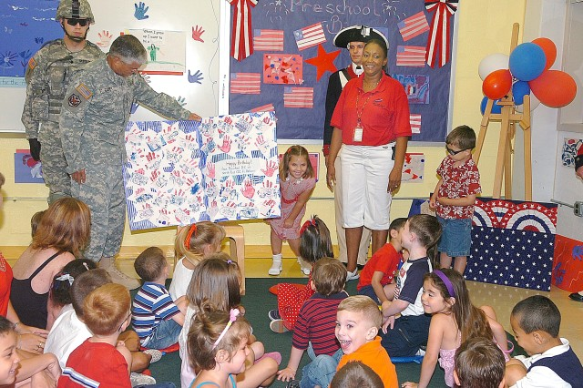 Gen. George W. Casey Jr., Army Chief of Staff, receives a Happy Birthday card from Fort Belvoir's Markham School Age Services. The Army celebrated its 233rd birthday. Casey read the new book, Happy Birthday Army, to the students.
