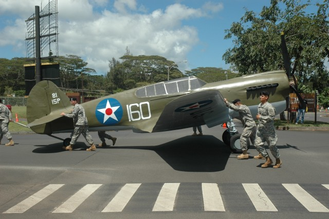 Historic P-40 aircraft returns to 'action' near Kawamura Gate