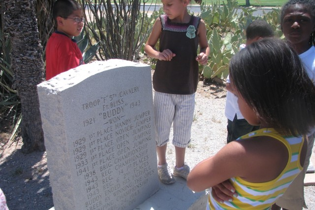Children with Main School Age Services discover the tombstones at the end of the trail at Old Fort Bliss are for Army horses and dogs, while participating in a scavenger hunt around Fort Bliss during the week-long celebration of the Army's 233rd Birthday. ""