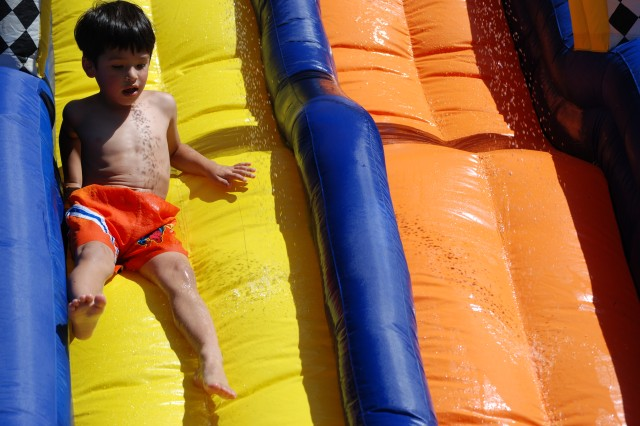 """Fort Bliss Child and Youth Services hosts a picnic with waterslides during Army Birthday Week."""""""