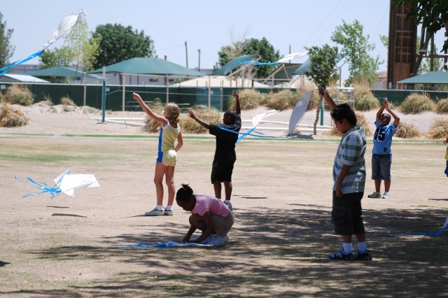 Fort Bliss School Age Services children fly kites in celebration of the Army's 233rd Birthday.""