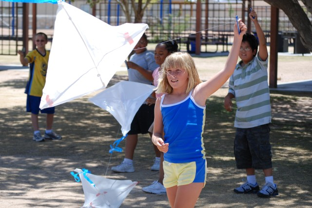 Children in the Fort Bliss School Age Services program celebrate the Army's 233rd Birthday with an afternoon of kite flying.""