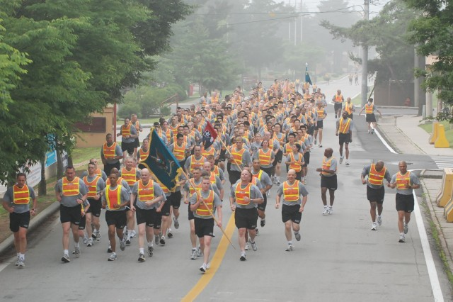 The 2nd Infantry Division staff leads the Division Special Troops Battalion in a four-mile run at Camp Red Cloud, Korea in celebration of the Army's 233rd Birthday June 13.