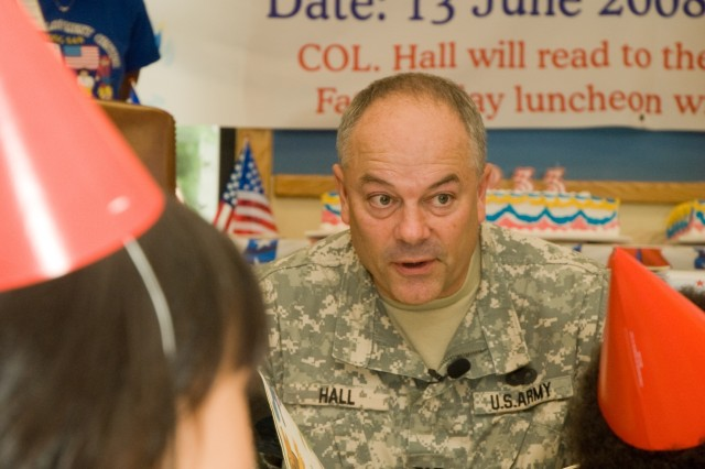 USAG-Yongsan Commander Col. Dave Hall reads the Army story to toddlers and preschoolers at the Child Development Center to celebrate the organization's 233rd birthday June 13.