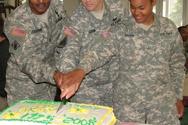 DARMSTADT, Germany - The community of U.S. Army Garrison Darmstadt celebrated the Army's Birthday June 12 with a luncheon and ceremony at the Kelley Dining Facility, the last such event for the closing installation. Lt. Col. David Astin (middle), commander of USAG Darmstadt; Command Sergeant Major Harold Littlejohn (left); and the youngest Soldier present, Pvt. 2 Mary Barba, 2nd Military Intelligence Battalion, cut the cake for attendees, who lined up around the dining hall to participate in the luncheon.