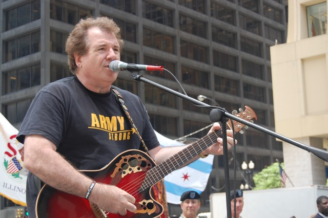 """Joe Cantafio, lead singer of the 101st Rock Division and a Chicago area resident, sings """"God Bless America"""" during a celebration in observance of the Army's 233rd birthday, at Daley Plaza June 11, 2008."""