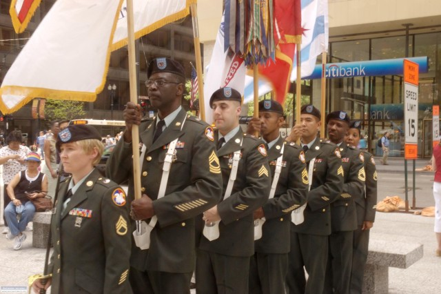 Soldier of the Color Guard from the U.S. Army Reserve Regional Support Group- West prepare to post the colors at a ceremony celebrating the Army's 233rd birthday at Daley Plaza June 11, 2008.