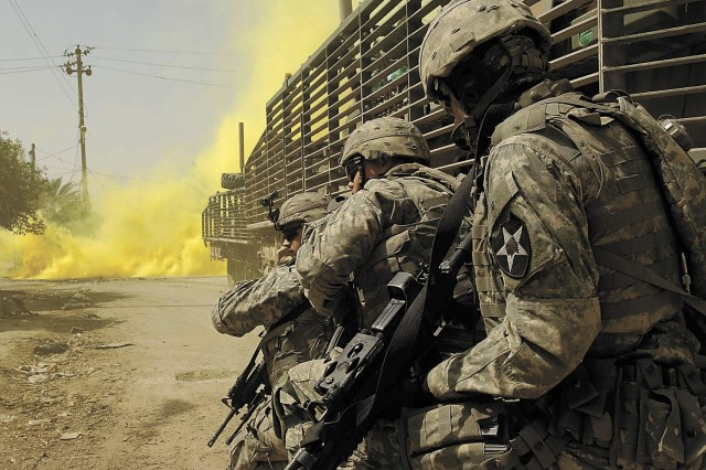 Soldiers from 5th battalion, 20th Infantry Regiment engage anti-Iraqi forces in Buhriz, Iraq, on March 14, 2007.