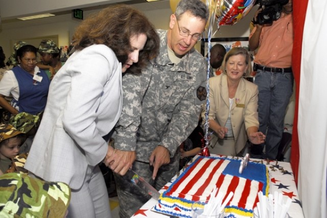 Fort Meade installation commander, COL Kenneth McCreedy and wife LeAnn mark the Army's Birthday with a cake-cutting ceremony at the Ft. Meade Child Development Center.
