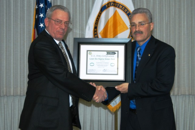 DMS Optimization LSS project lead Lawrence Couture (left) receives his Green Belt Certification from Dan Bradford, Senior Technical Director/Chief Engineer, NETCOM/9th Signal Command (Army), during a ceremony held in the command's conference room.