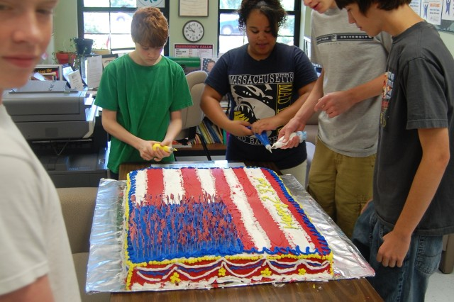 Teens at the school age center who baked and decorated the Army Birthday cake under the supervision of Sgt. Alicia Hight, an award-winning chef from the All-Army Culinary Team.