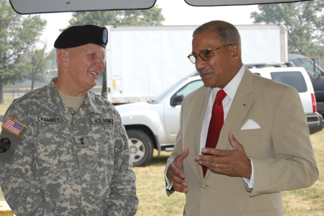 Maj. Gen. James E. Chambers, Combined Arms Support Command and Fort Lee commanding general, talks with former secretary of the Army The Honorable Togo D. West Jr., before the start of Fort Lee's Army Birthday celebration June 13 at Williams Stadium.