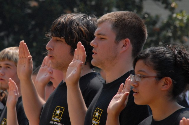 Future Soldiers, including Gabriel Dubois (third from right) are sworn in at the Pentagon on June 13.