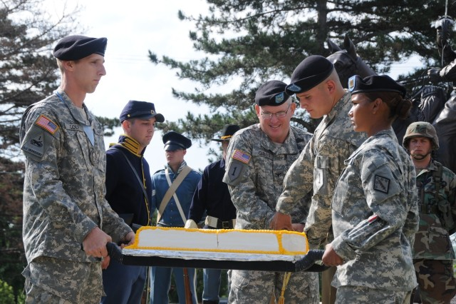 At Fort Riley, a cake is cut, celebrating Army's 233rd Birthday