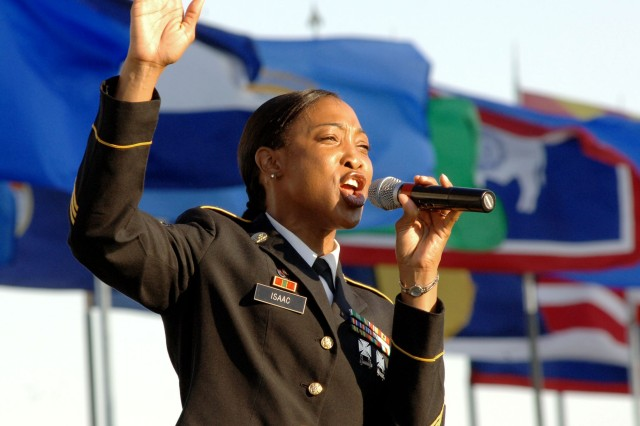 """Staff Sgt. Patricia Isaac of the U.S. Army Training and Doctrine Command Band sings """"Victory Starts Here"""" during the June 12 Music Under the Stars 2008 Army Birthday Concert and Battle Streamer Ceremony conducted at Fort Monroe, Va. The concert also featured a performance by members of The U.S. Army Old Guard Fife and Drum Corps. During the Battle Streamer Ceremony, Soldiers from Forts Monroe and Eustis modeled Army uniforms from the colonial era to present day."""