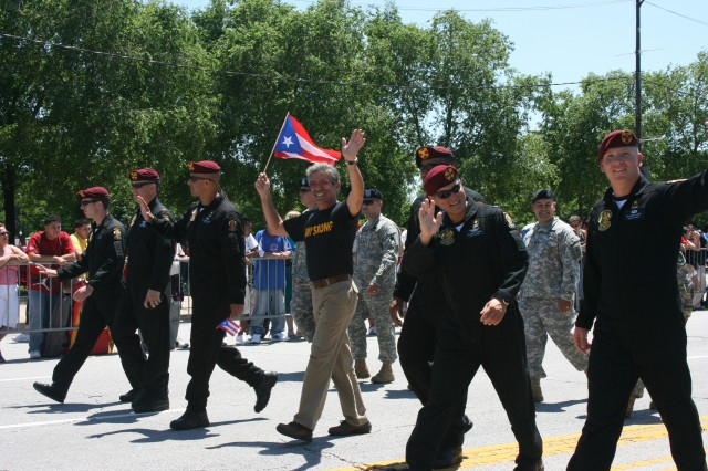 Geraldo Rivera marches along side Soldiers and the U.S. Army's premier parachute team, The Golden Knights, during the Puerto Rican Day Parade in Chicago, IL, Saturday, June 14, 2008.
