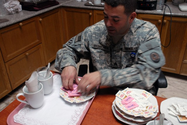Sgt. Daniel B. McMichen, Multi-National Corps - Iraq, arranges sugar and sweetner packets prior to a working lunch at Al Faw Palace. Part of McMichen's job is to ensure that important guests have everything they need when they visit Multi-National Corps - Iraq.